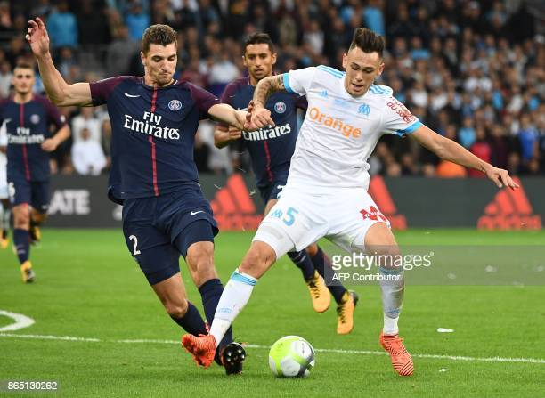 Marseille's Argentinian forward Lucas Ocampos vies for the ball with Paris SaintGermain's Belgian defender Thomas Meunier during the French L1...