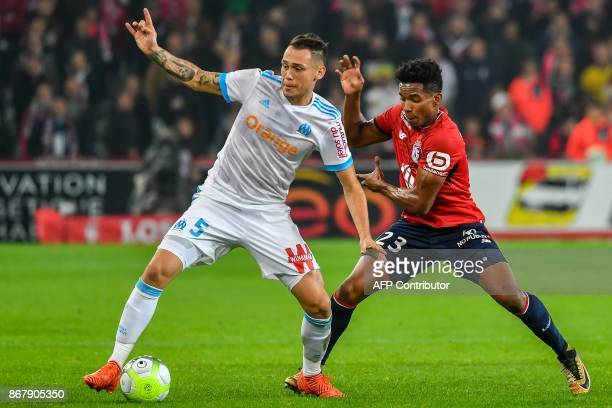 Marseille's Argentinian forward Lucas Ocampos vies with Lille's Brazilian forward Thiago Mendes during the French L1 football match between Lille OSC...