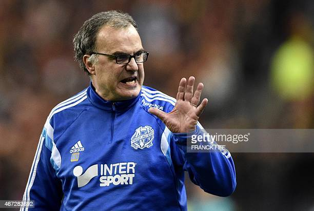 Marseille's Argentinian head coach Marcelo Bielsa gestures during the French L1 football match between Lens and Marseille on March 22 2014 at the...