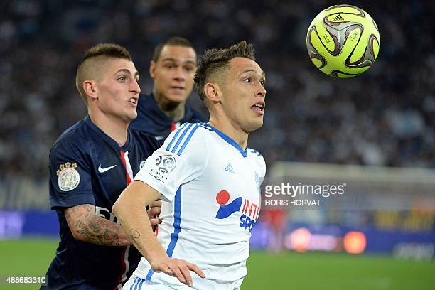 Marseille's Argentinian midfielder Lucas Ocampos vies for the ball with Paris SaintGermain's Italian midfielder Marco Verratti during the French L1...