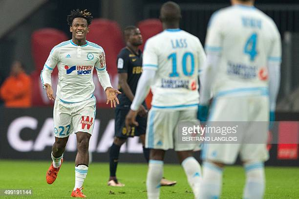 Marseille's Belgian forward Michy Batshuayi celebrates after scoring a goal during the French L1 football match Olympique de Marseille vs AS Monaco...