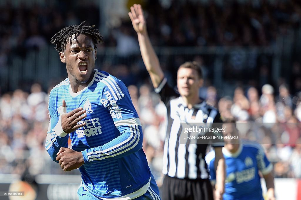 Marseille's Belgian forward Michy Batshuayi celebrates after scoring during the French L1 football match between Angers and Marseille on May 1, 2016 at the Jean Bouin stadium in Angers, western France.