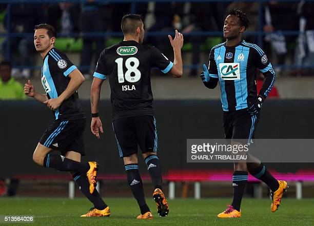 Marseille's Belgian forward Michy Batshuayi celebrates with teammates after scoring a goal during the the French Cup quarter final football match...