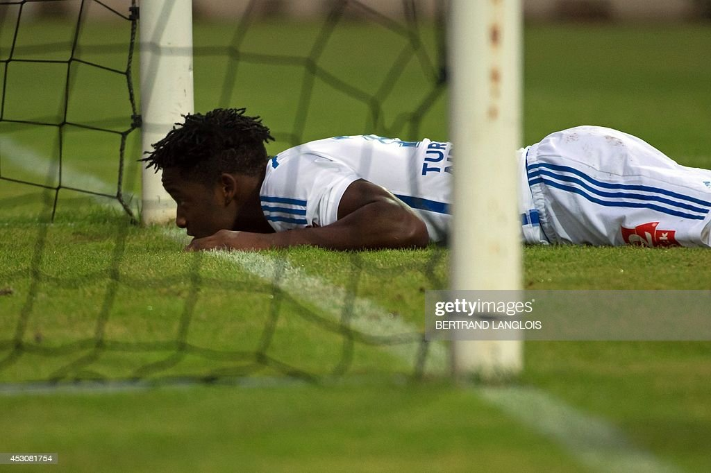 Marseille's Belgian forward Michy Batshuayi lies on the pitch near the nets during the friendly football match Olympique de Marseille vs Chievo Verona on August 2, 2014 in Le Pontet, southern France.