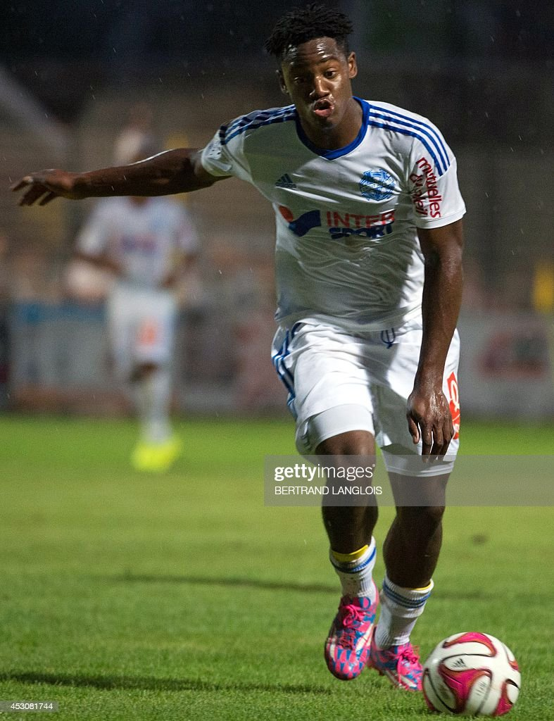 Marseille's Belgian forward Michy Batshuayi runs with the ball during the friendly football match Olympique de Marseille vs Chievo Verona on August 2, 2014 in Le Pontet, southern France.