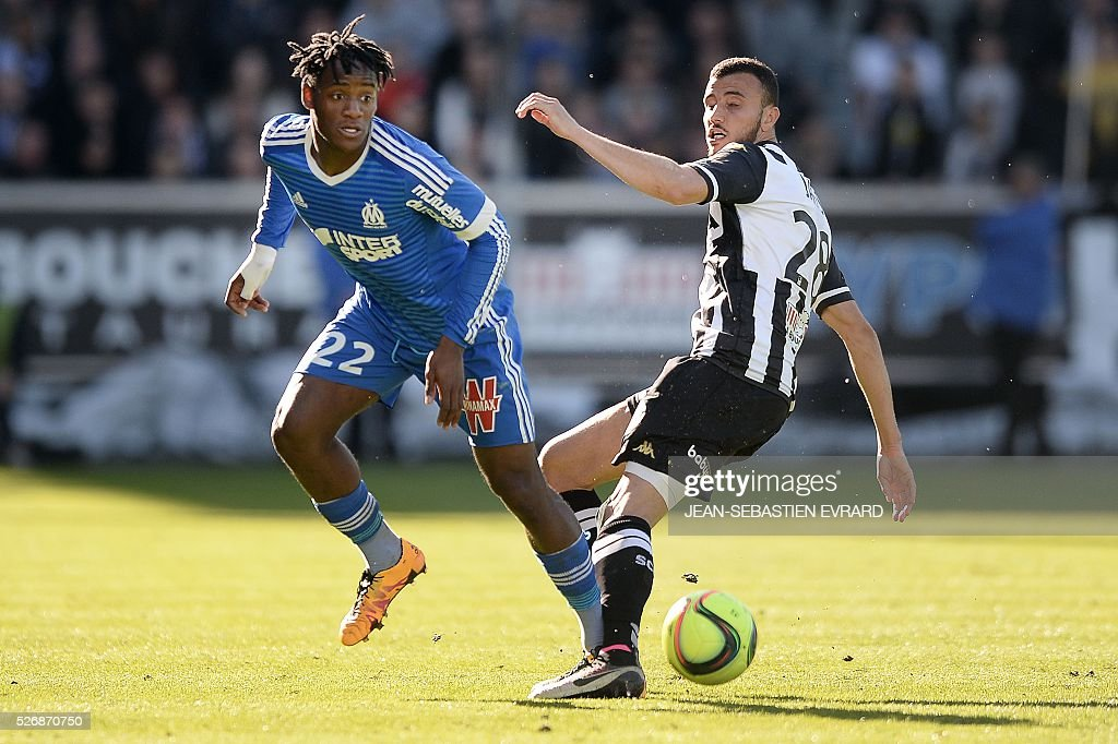 Marseille's Belgian forward Michy Batshuayi (L) vies with Angers' Moroccan midfielder Romain Saiss during the French L1 football match between Angers and Marseille on May 1, 2016 at the Jean Bouin stadium in Angers, western France.