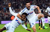 Marseille's Belgian midfielder Michy Batshuayi celebrates with Marseille's French forward AndrePierre Gignac after scoring a goal on November 23 2014...
