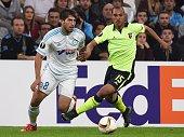 Marseille's brazilian midfielder Lucas Silva Borges vies with Braga's defender Baiano during the UEFA Europa League football match between Marseille...