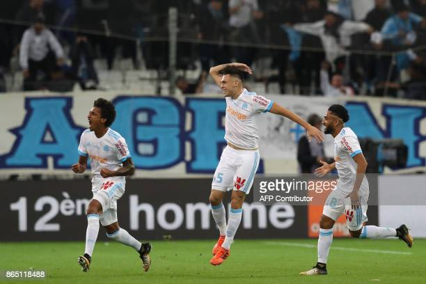 Marseille's Brazilian midfielder Luiz Gustavo celebrates after scoring a goal during the French L1 football match between Marseille and Paris...