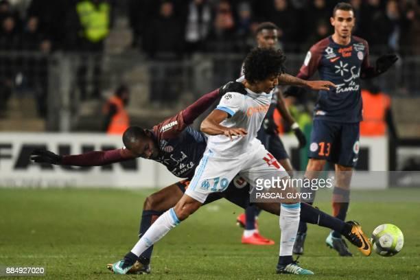 Marseille's Brazilian midfielder Luiz Gustavo outruns Montpellier's Ivorian forward Giovanni Sio during the French L1 football match between...