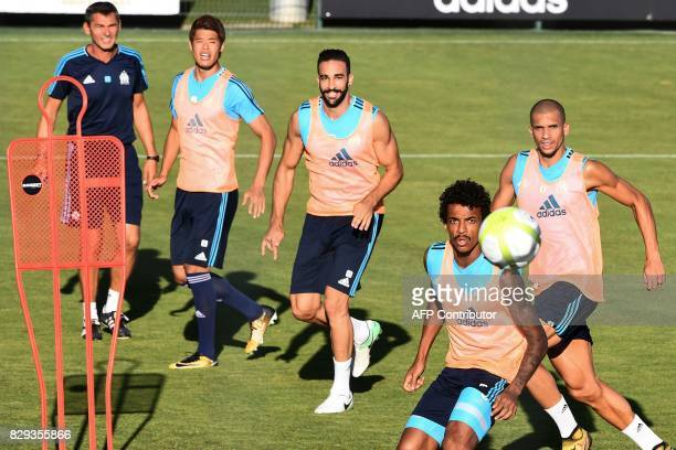 Marseille's Brazilian midfielder Luiz Gustavo practices during a training session on August 10 2017 at the RobertLouis Dreyfus training centre in...