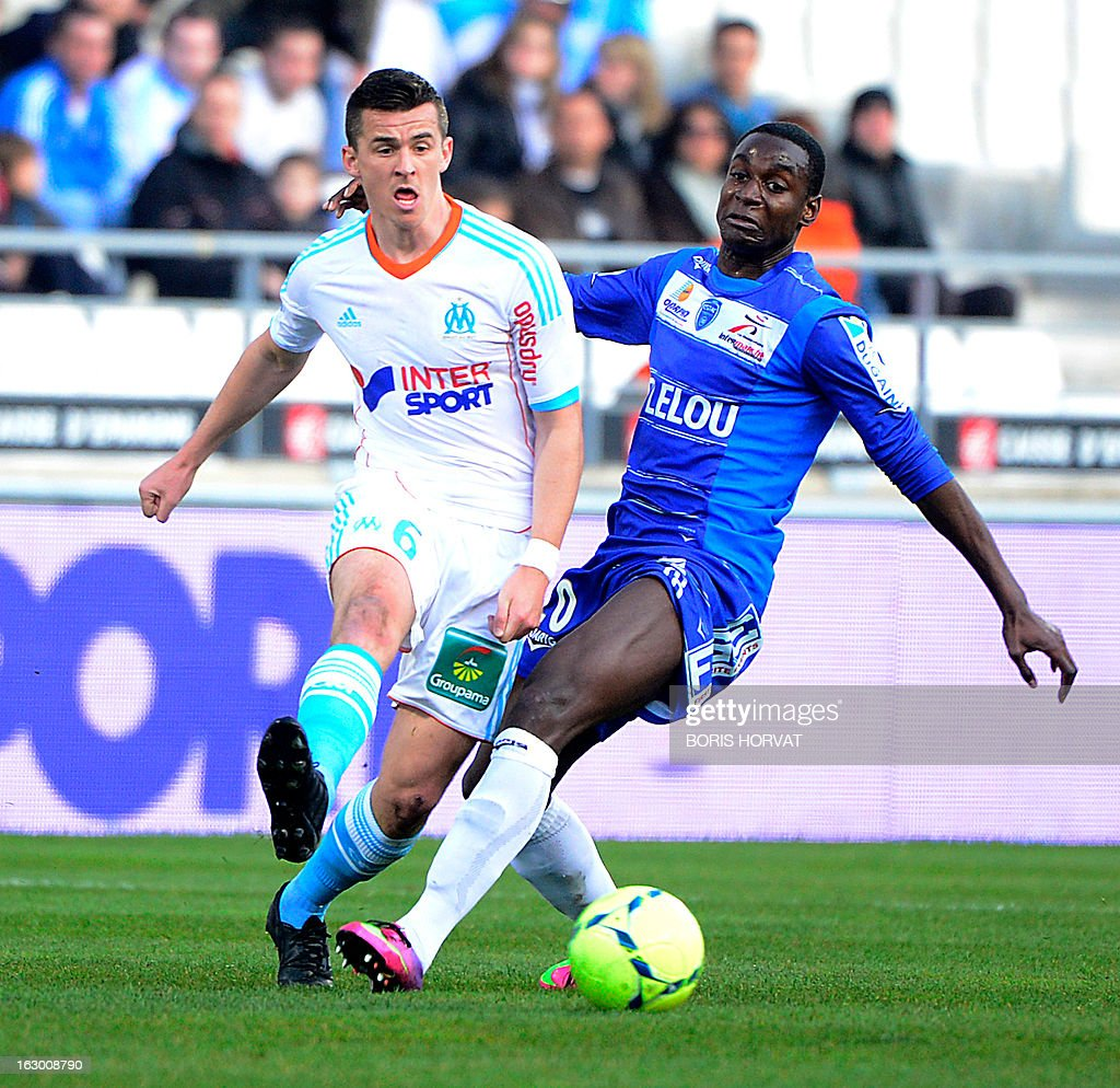 Marseille's British midfielder Joey Barton (L) vies with Troyes' French-Congolese midfielder Granddi Ngoyi (R) during their French L1 football match Olympique of Marseille (OM) versus Troyes (ESTAC) at the Velodrome stadium in Marseille, on March 3, 2013.