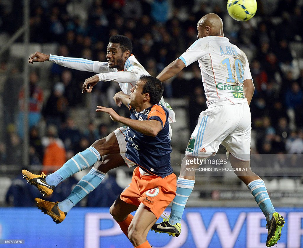 Marseille's Cameroonian defender Nicolas Nkoulou (L) and Marseille's Ghanaian forward Andre Ayew (R) vie with Montpellier's Brazilian defender Vitorino Hilton (C) during the French L1 football match Marseille (OM) vs Montpellier (MHSC) on January 19, 2013 at the Velodrome stadium in Marseille, southern France.