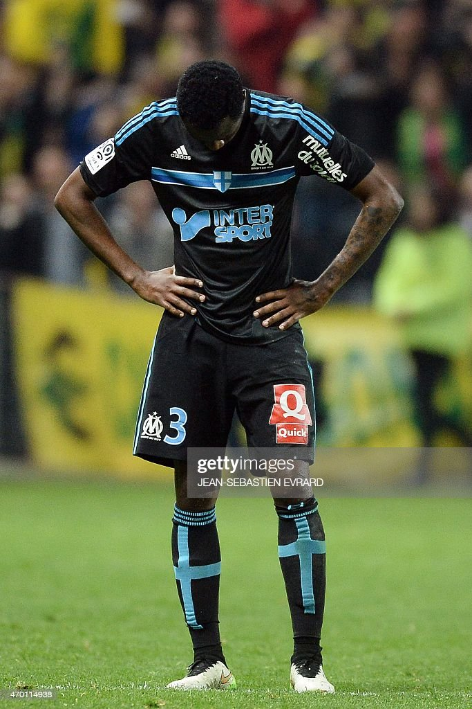 Marseille's Cameroonian defender <a gi-track='captionPersonalityLinkClicked' href=/galleries/search?phrase=Nicolas+Nkoulou&family=editorial&specificpeople=5398235 ng-click='$event.stopPropagation()'>Nicolas Nkoulou</a> reacts at the end of the French L1 football match between Nantes and Marseille on April 17, 2015 at the Beaujoire stadium in Nantes, western France. AFP PHOTO / JEAN-SEBASTIEN EVRARD