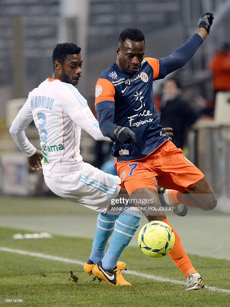 Marseille's Cameroonian defender Nicolas Nkoulou (L) vies for the ball with Montpellier's Nigerian forward John Utaka on January 19, 2013, at the Velodrome stadium in Marseille, southern France, during the French L1 football match between Marseille and Montpellier.