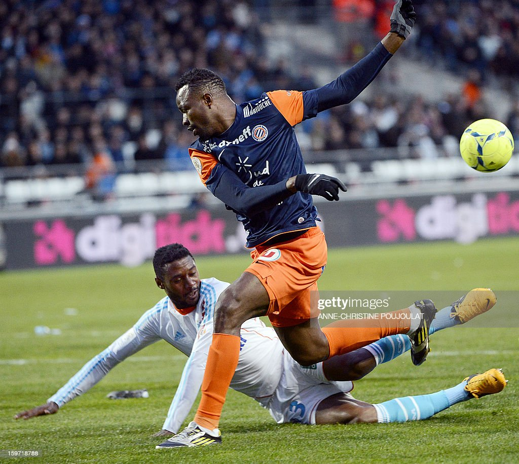 Marseille's Cameroonian defender Nicolas Nkoulou (Bottom L) vies with Montpellier's Nigerian forward John Utaka on January 19, 2013, at the Velodrome stadium in Marseille, southern France, during the French L1 football match between Marseille and Montpellier.