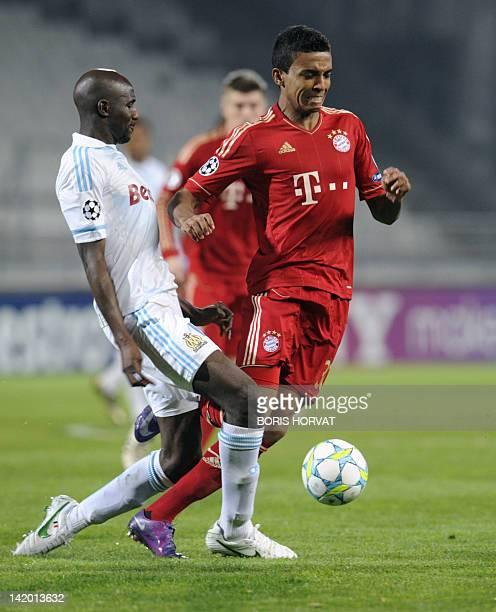 Marseille's Cameroonian midfielder Stephane Mbia vies with Bayern Munich's Brazilian midfielder Luiz Gustavo during the UEFA Champions League quarter...