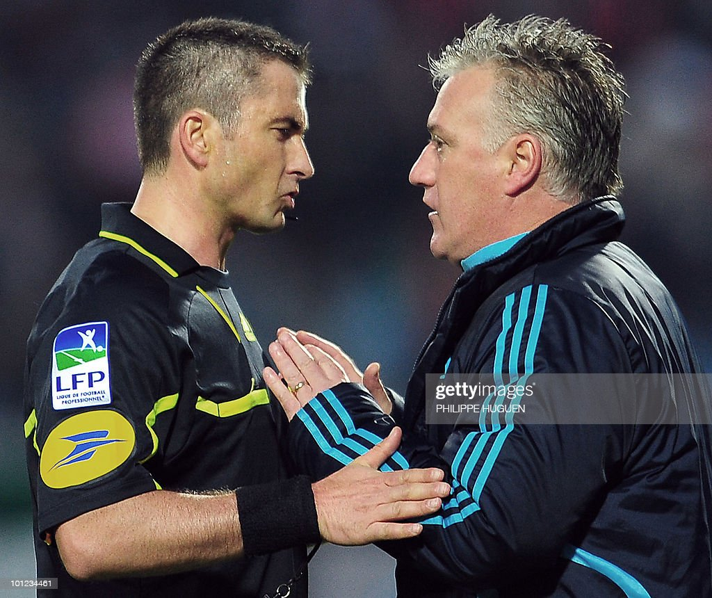 Marseille's coach Didier Deschamps (R) speaks to the referee Fredy Fautrel during the French L1 football match Lille vs. Marseille on May 8, 2010 at the Lille metropole stadium in Villeneuve d'Ascq, northern France.