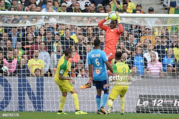 Marseille's Congolese goalkeeper Steve Mandanda stops the ball during the French L1 football match between Nantes and Olympique de Marseille on...