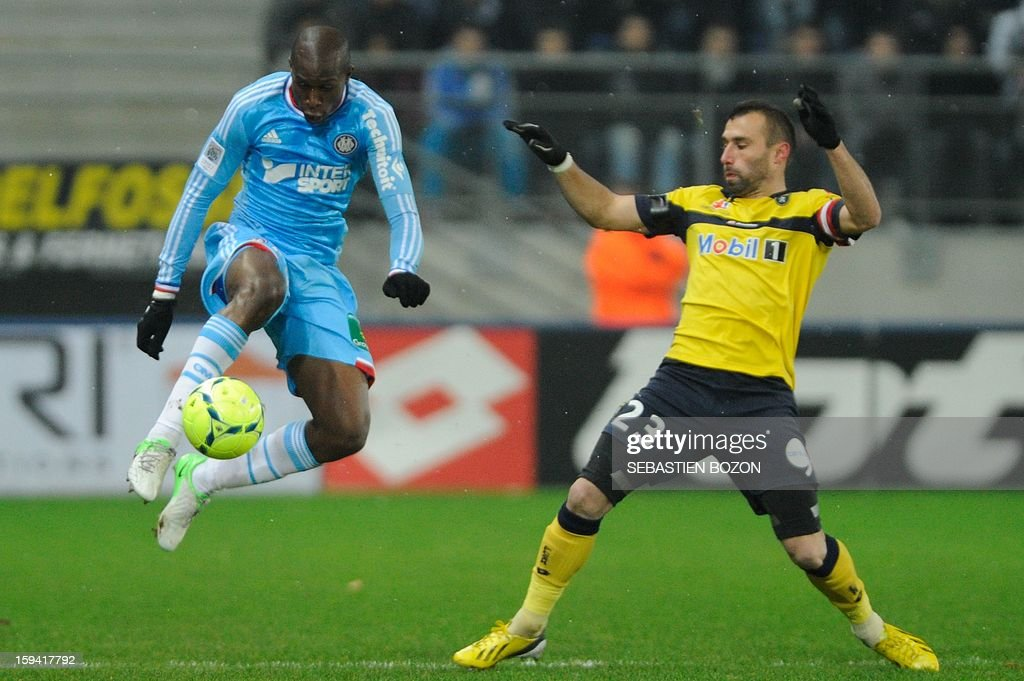 Marseille's defender Fanni Rod (L) vies with Sochaux's defender David Sauget during the French L1 football match Sochaux (FCSM) vs Marseille (OM) at the August Bonal Stadium in Montbeliard, on January 13, 2013.