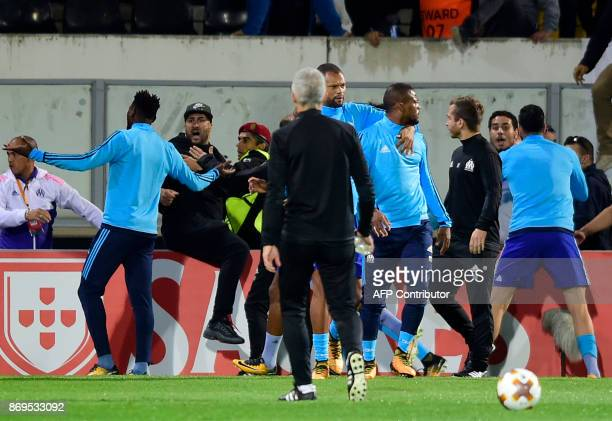 TOPSHOT Marseille's defender Patrice Evra leaves the pitch after an incident with Marseille supporters before the start of the UEFA Europa League...