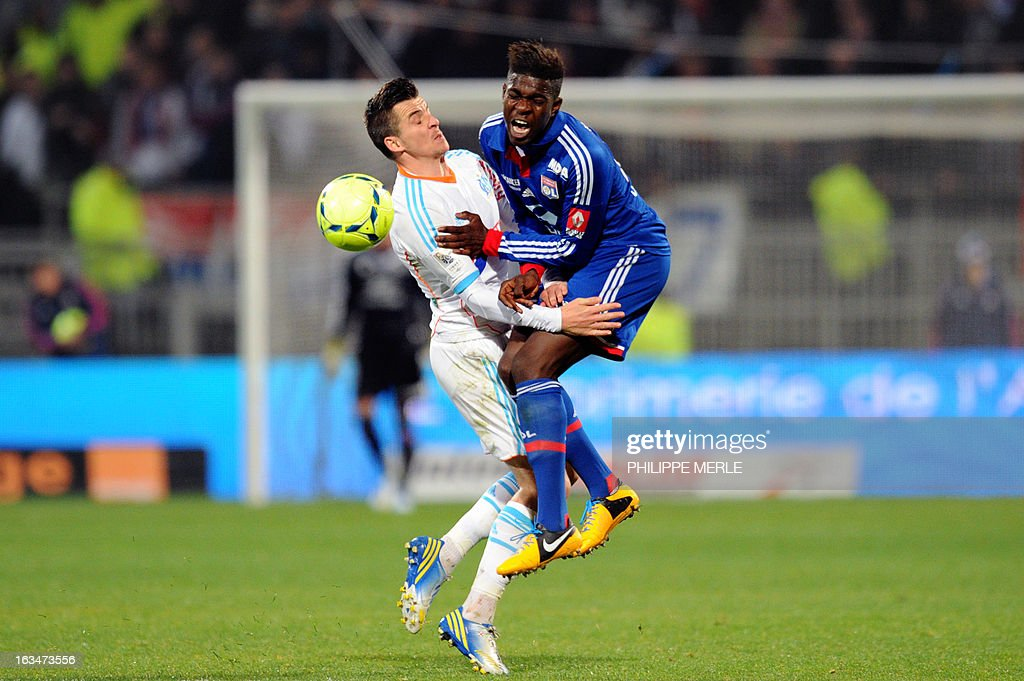 Marseille's English midfielder Joey Barton (L) vies for the ball with Lyon's French defender Samuel Umtiti during the French L1 football match Olympique Lyonnais (OL) vs Olympique de Marseille (OM) on March 10, 2013 at the Gerland stadium in Lyon, southeasthern France.