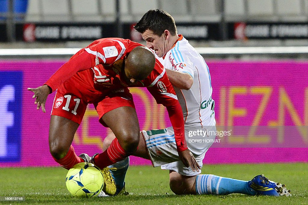 Marseille's english midfielder Joey Barton (R) vies with Nancy's French forward Djamel Bakar (L)during their French L1 football match Olympique of Marseille (OM) versus Nancy (ASNL) at the Velodrome stadium in Marseille on February 3, 2013. AFP PHOTO / BORIS HORVAT