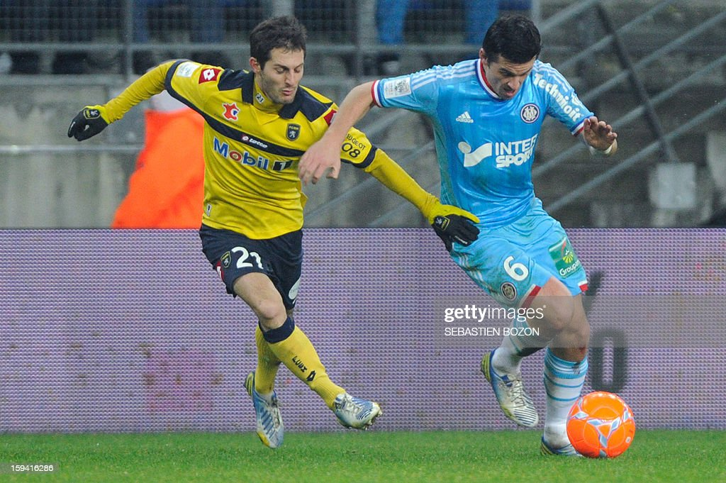 Marseille's English midfielder Joey Barton (R) vies with Sochaux' French midfielder Vincent Nogueira (L) during their French L1 football match Sochaux (FCSM) versus Marseille (OM) at the August Bonal Stadium in Montbeliard, on January 13, 2013