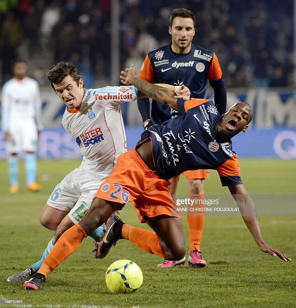 Marseille's English mildfielder Joey Barton (L) vies for the ball with Montpellier's French defender Bryan Dabo (R) on January 19, 2013, at the Velodrome stadium in Marseille, southern France, during the French L1 football match between Marseille and Montpellier.