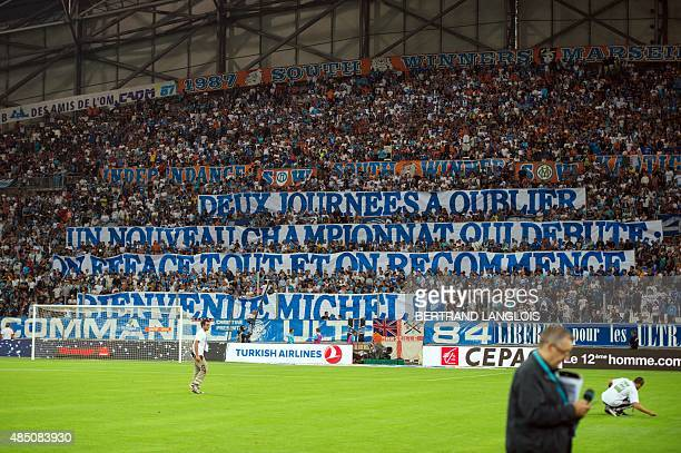 Marseille's fans hold banners to welcome Marseille's Spanish head coach Jose Miguel Gonzalez Martin del Campo aka Michel prior to the French L1...