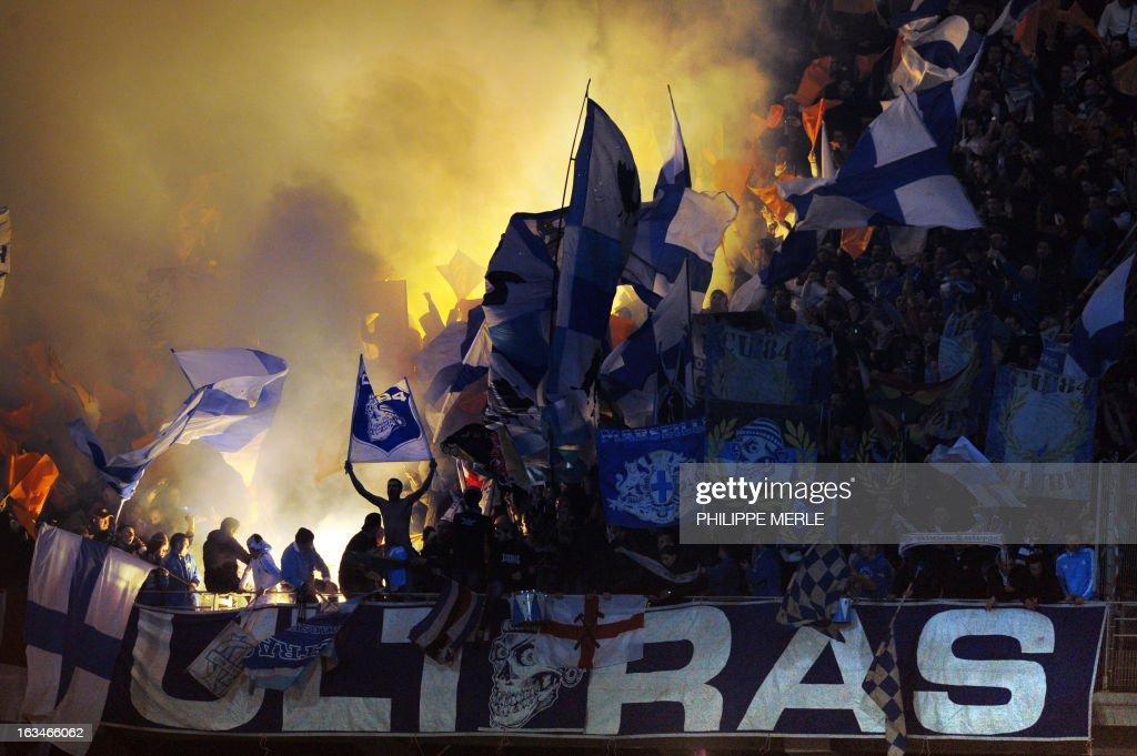 Marseille's fans react during the French L1 football match Olympique Lyonnais (OL) vs Olympique de Marseille (om) on March 10, 2013 at the Gerland stadium in Lyon, southeasthern France.