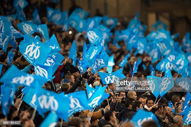 Marseille's fans wave flags prior to the French L1 football match Olympique de Marseille vs AS Monaco on November 29 2015 at the Velodrome stadium in...