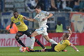 Marseille's Florian Thauvin vies for the ball with Sochaux' defenders Sekou Cisse and Florian Martin during the French Cup semifinal football match...