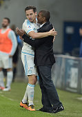 Marseille's forward Florian Thauvin celebrates his goal with his coach Franck Passi during the French Cup semifinal football match between Sochaux...