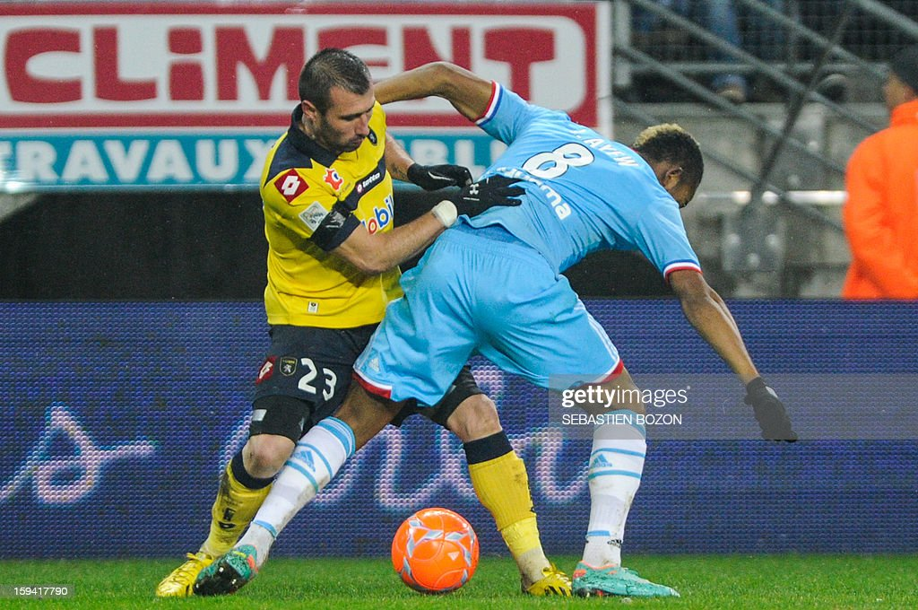 Marseille's forward Jordan Ayew (R) vies with Sochaux's defender David Sauget (L) during the French L1 football match Sochaux (FCSM) vs Marseille (OM) at the August Bonal Stadium in Montbeliard, on January 13, 2013.