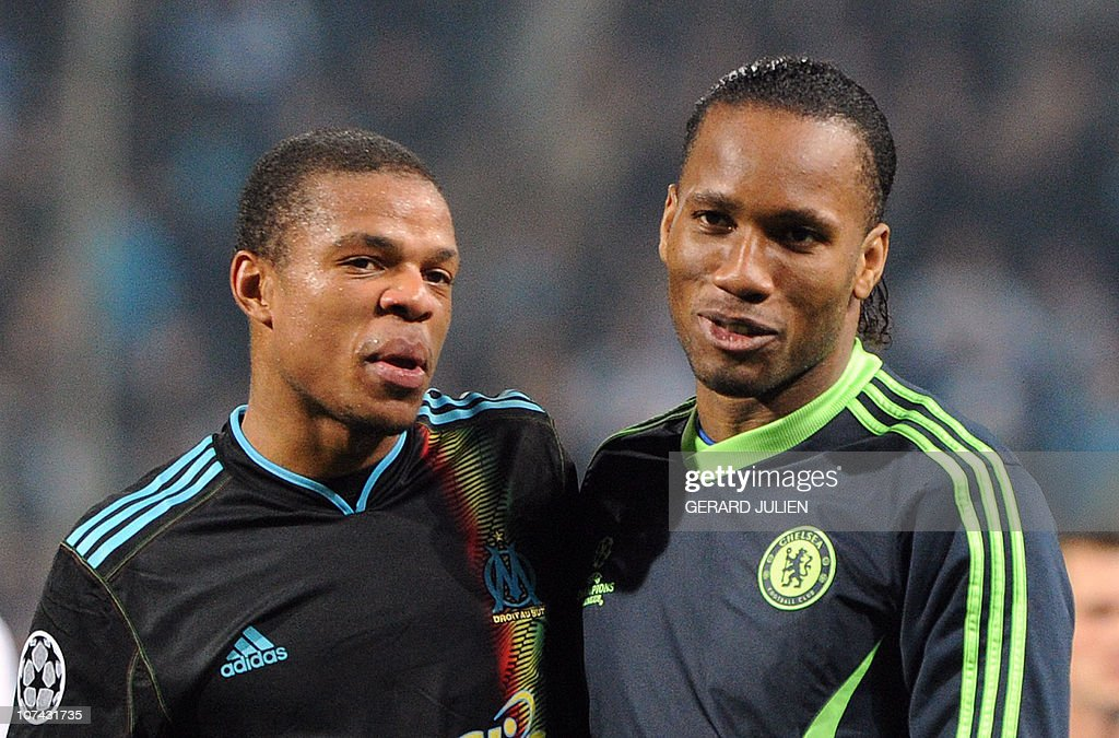 Marseille's forward Loic Remy (L) chats with Chelsea's forward Didier Drogba (R) after the UEFA Champions League Group F football match Marseille vs Chelsea, on December 8, 2010 at the Velodrome stadium in Marseille, southern France. Marseille won 1 to 0.