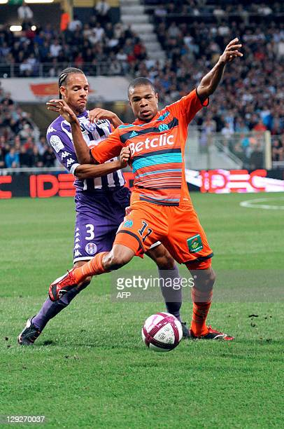Marseille's forward Loic Remy vies with Toulouse's defender and captain Daniel Congre during the French L1 football match Toulouse vs Marseille on...
