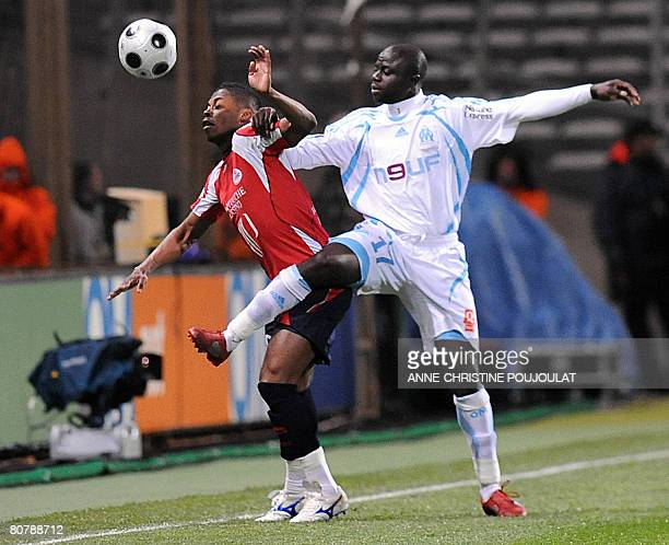 Marseille's forward Modeste M'Bami vies with Lille's defender Michel Bastos Fernandes during their French L1 football match on April 20 2008 at the...