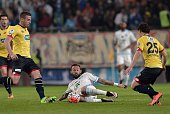 Marseille's forward Steven Fletcher vies for the ball with Sochaux' defenders Pierre Gibaud and Julien Faussurier during the French Cup semifinal...
