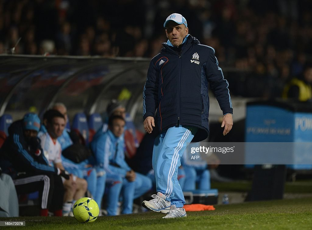 Marseille's French coach Elie Baup shoots the ball during the French L1 football match Olympique Lyonnais (OL) vs Olympique de Marseille (OM) on March 10, 2013 at the Gerland stadium in Lyon, southeasthern France. AFP PHOTO/PHILIPPE DESMAZES