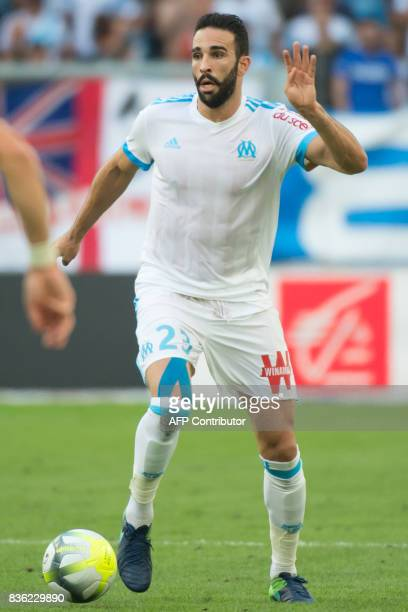 Marseille's French defender Adil Rami runs with the ball during the French L1 football match Olympique de Marseille vs Angers on August 20 2017 at...