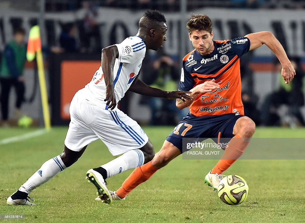 Marseille's French defender <a gi-track='captionPersonalityLinkClicked' href=/galleries/search?phrase=Benjamin+Mendy&family=editorial&specificpeople=7029850 ng-click='$event.stopPropagation()'>Benjamin Mendy</a> (L) challenges Montpellier's French midfielder Paul Lasne (R) during the French L1 football match Montpellier vs Olympique de Marseille, on January 9, 2015 at the La Mosson Stadium in Montpellier, southern France.