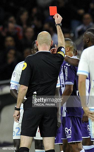 Marseille's French defender Benjamin Mendy is given a red card by French referee Antony Gautier during the French L1 football match Toulouse vs...