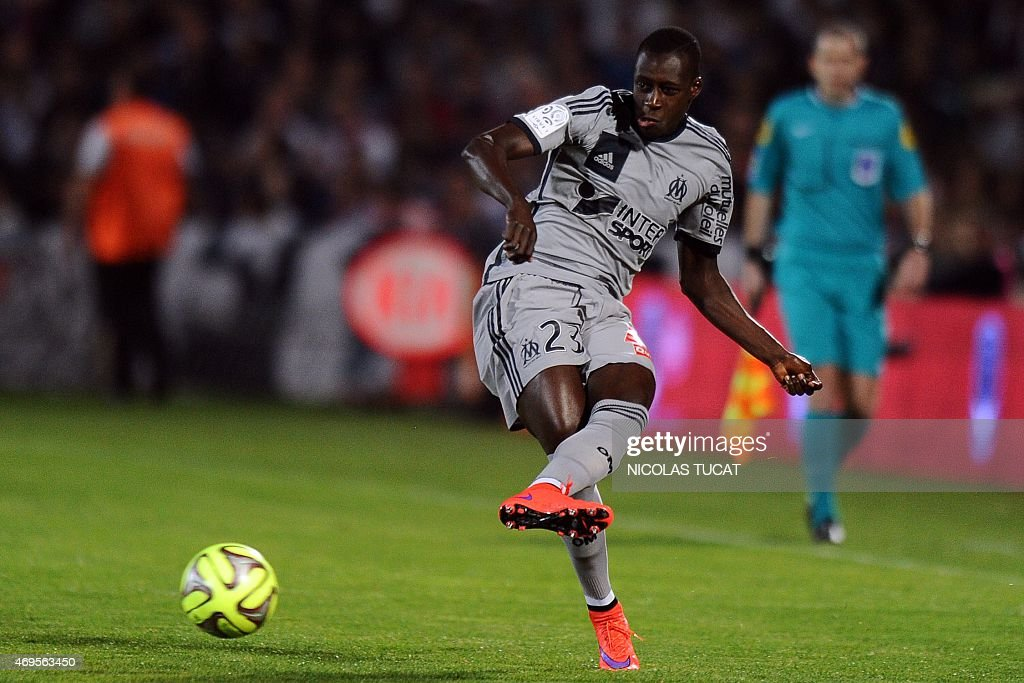 Marseille's French defender <a gi-track='captionPersonalityLinkClicked' href=/galleries/search?phrase=Benjamin+Mendy&family=editorial&specificpeople=7029850 ng-click='$event.stopPropagation()'>Benjamin Mendy</a> passes the ball during a French L1 football match between Bordeaux (FCGB) and Marseille (OM) on April 12, 2015 at the Chaban-Delmas stadium in Bordeaux, southwestern France. AFP PHOTO / NICOLAS TUCAT