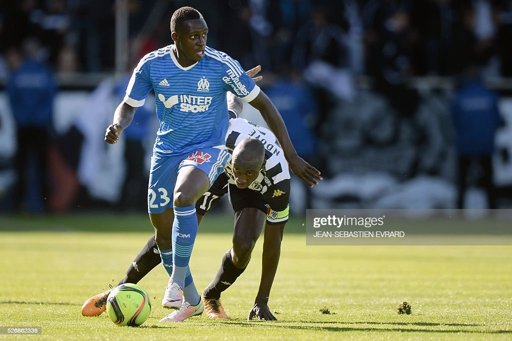 Marseille's French defender Benjamin Mendy (L) vies with Angers' Senegalese midfielder Cheikh N'Doye during the French L1 football match between Angers and Marseille on May 1, 2016 at the Jean Bouin stadium in Angers, western France.