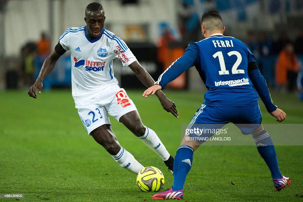 Marseille's French defender <a gi-track='captionPersonalityLinkClicked' href=/galleries/search?phrase=Benjamin+Mendy&family=editorial&specificpeople=7029850 ng-click='$event.stopPropagation()'>Benjamin Mendy</a> (L) vies with Lyon's French midfielder Jordan Ferri during the French L1 football match Olympique de Marseille (OM) vs Lyon (OL), on March 15, 2015 at the Velodrome stadium in Marseille, southern France. AFP PHOTO / BERTRAND LANGLOIS