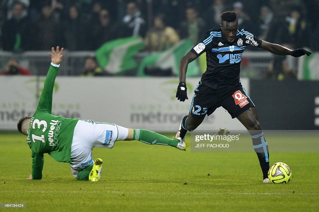 Marseille's French defender <a gi-track='captionPersonalityLinkClicked' href=/galleries/search?phrase=Benjamin+Mendy&family=editorial&specificpeople=7029850 ng-click='$event.stopPropagation()'>Benjamin Mendy</a> (R) vies with St Etienne's Dutch forward Ricky Van Wolfswinkel (L) during the French L1 football match AS Saint-Etienne (ASSE) vs Olympique de Marseille (OM) on February 22, 2015, at the Geoffroy Guichard Stadium in Saint-Etienne, central France. AFP PHOTO / JEFF PACHOUD