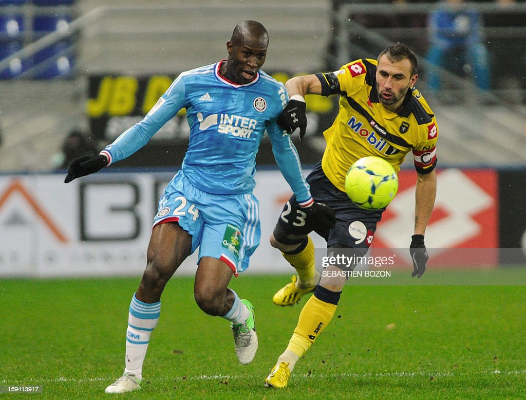Marseille's French defender Fanni Rod (L) vies for the ball with Sochaux' French defender David Sauget (R) during the French L1 football match between Sochaux (FCSM) and Marseille (OM) at the August Bonal Stadium in Montbeliard, on January 13, 2013.