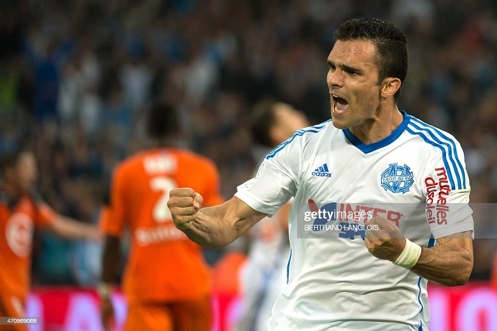 Marseille's French defender <a gi-track='captionPersonalityLinkClicked' href=/galleries/search?phrase=Jeremy+Morel&family=editorial&specificpeople=650503 ng-click='$event.stopPropagation()'>Jeremy Morel</a> celebrates after scoring a goal during the French L1 football match between Marseille and Lorient on April 24, 2015 at the Velodrome stadium in Marseille, southern France.