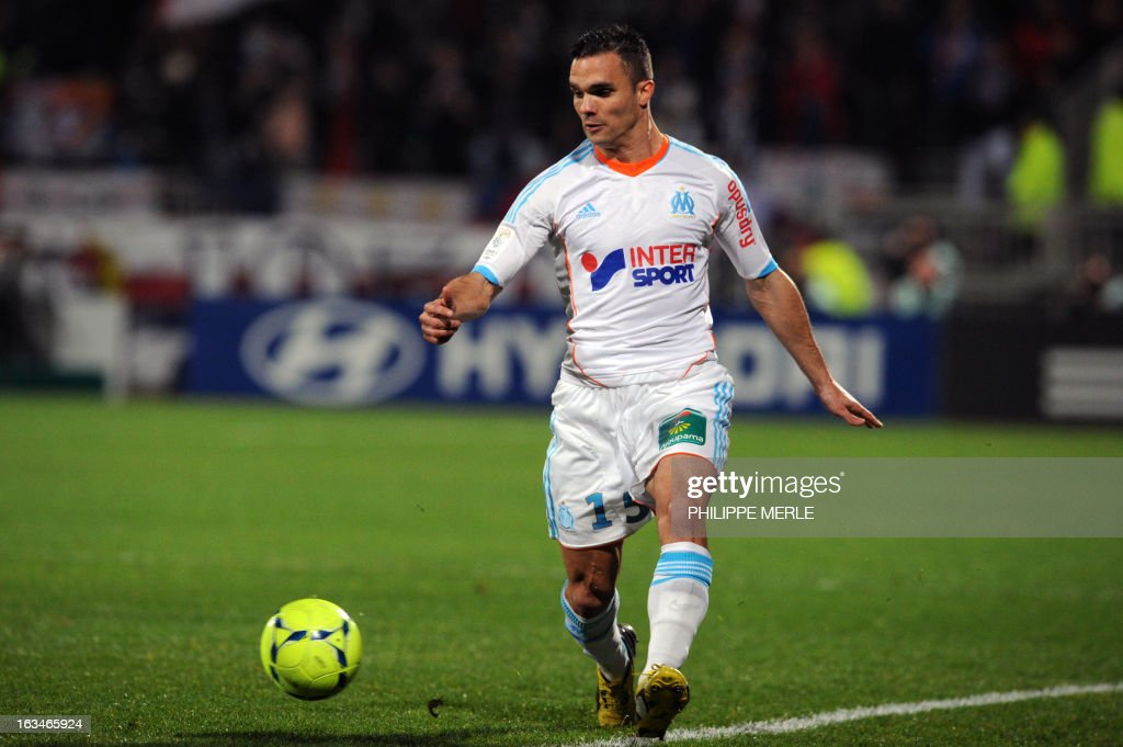 Marseille's French defender Jeremy Morel runs with the ball during the French L1 football match Olympique Lyonnais (OL) vs Olympique de Marseille (OM) on March 10 , 2013 at the Gerland stadium in Lyon.